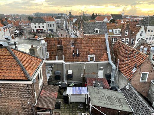 Afbeelding #000 voor het verhaal De boven- en achterkant van De Stad, vanaf het dak van Brooklyn